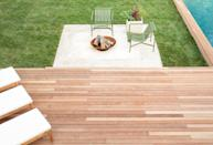 "<p>In this backyard designed by <a href=""http://www.robertmckinley.com/"" rel=""nofollow noopener"" target=""_blank"" data-ylk=""slk:Robert McKinley Studio"" class=""link rapid-noclick-resp"">Robert McKinley Studio</a>, the small deck is optimized for sun lounging with a couple of recliners, but the designer added an additional hangout space on the lawn with a fire pit and chairs since it couldn't all fit on the deck. </p>"