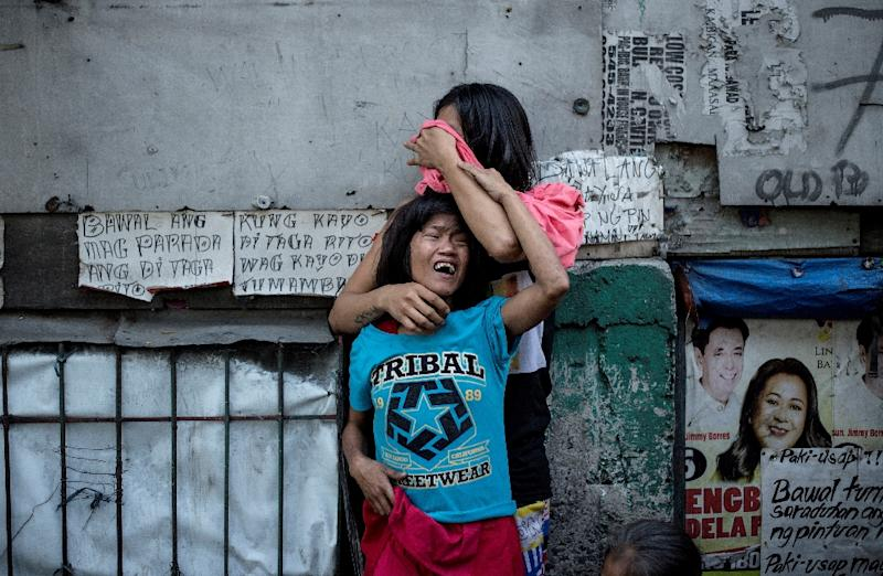 Police have reported killing about 2,700 people since Duterte took office at the end of June and immediately launched his war on drugs, while unknown assailants have killed more than 1,800 others. (AFP Photo/NOEL CELIS)