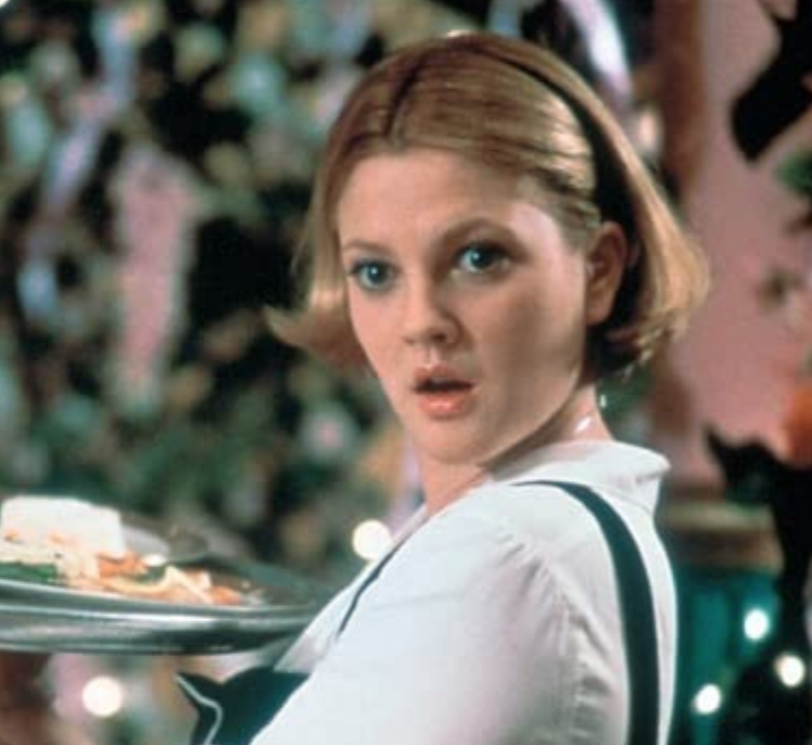 <p>Here, we have another short bob. But it's Drew Barrymore's center part that makes her <em>The Wedding Singer </em>look a standout.</p>