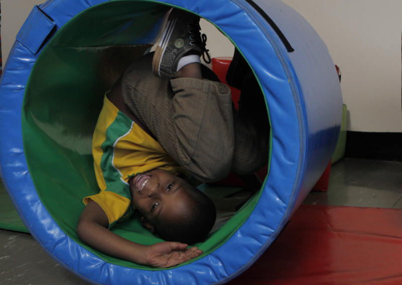 A child tumbles in a tube at a toy library and play center run by Cotlands, a local non-profit organization that promotes early learning opportunities for children, on World Play Day in Johannesburg, Tuesday, May 28, 2013. Cotlands first opened it's doors 77 years ago offering adoption services for abandoned babies. In 1996 it opened an HIV hospice to address the increased HIV birth rate which claimed 98 children in 2002. In the past three years no child has died leading to the closure of the HIV hospice and now prioritizes it's efforts into advocation for an improvement in early childhood education. (AP Photo/Denis Farrell)