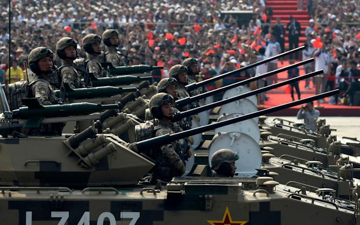 Military vehicles roll down during a parade to commemorate the 70th anniversary of the founding of Communist China - AP
