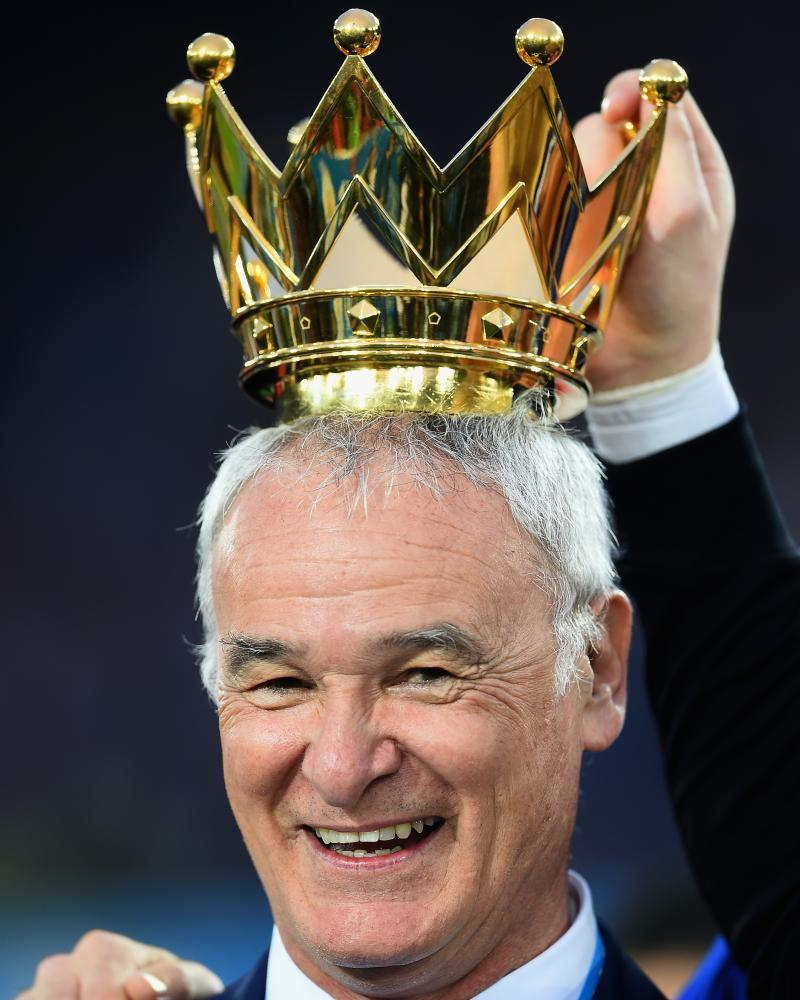 Claudio Ranieri with the crown of the Premier League trophy above his head