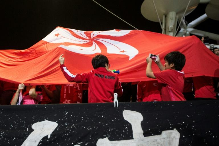 A Hong Kong fan makes a gesture and turns his back during the Chinese national anthem before an international friendly football match between Hong Kong and Bahrain at Mong Kok Stadium