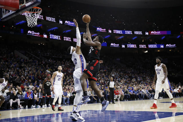 Toronto Raptors' OG Anunoby (3) goes up for a shot against Philadelphia 76ers' Tobias Harris (12) during the first half of an NBA basketball game, Sunday, Dec. 8, 2019, in Philadelphia. (AP Photo/Matt Slocum)