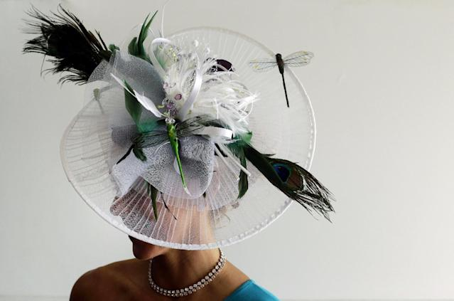 Erica Miller, of Springboro Ohio, wears a homemade hat at Pimlico Race Course in Baltimore, Saturday, May 17, 2014, before the 139th running of the Preakness Stakes horse race. (AP Photo/Patrick Semansky)