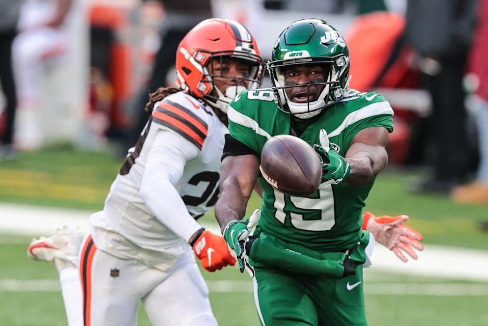 New York Jets receiver Breshad Perriman reaches for the ball as Cleveland Browns safety Sheldrick Redwine defends Dec. 27, 2020 in East Rutherford, N.J.