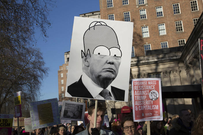 <p>People hold signs during the Women's March in London, to coincide with the first day of Donald Trump's Presidency, Jan. 21,2017. (Photo: Mike Kemp/In Pictures via Getty Images) </p>