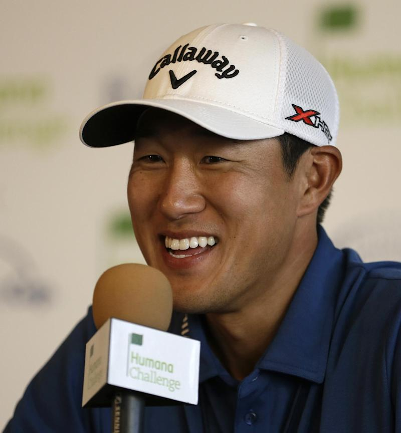 James Hahn smiles during a media conference after finishing his second round of the Humana Challenge PGA golf tournament  at the La Quinta Country Club Course at PGA West Friday, Jan. 18, 2013, in La Quinta, Calif. Hahn is tied for the lead with Roberto Castro. (AP Photo/Ben Margot)