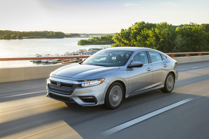 This undated photo provided by Honda shows the 2020 Honda Insight, a compact hybrid sedan with an EPA-estimated 48 mpg in mixed driving. (American Honda Motor Co. via AP)