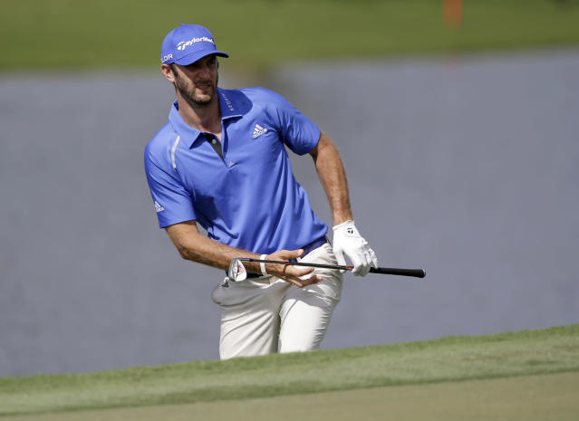 Dustin Johnson watches his shot on the ninth hole during a practice round of the Cadillac Championship golf tournament, Wednesday, March 5, 2014 in Doral, Fla. (AP Photo/Wilfredo Lee)