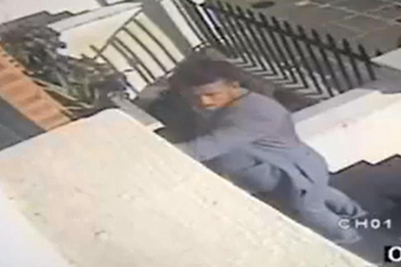 CCTV footage shows him breaking into a property in Belsize Park