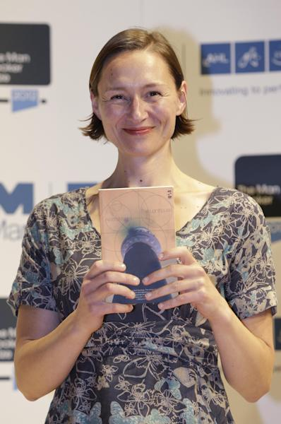 Author Alison Moore, shortlisted for the Man Booker Prize, holds a copy of her book 'The Lighthouse' during a photo call at the Royal Festival Hall, in London, Monday Oct. 15, 2012. The 50,000 British pounds (US 80,000 dlrs) prize will be announced Tuesday, Oct. 16. (AP Photo/Lefteris Pitarakis)