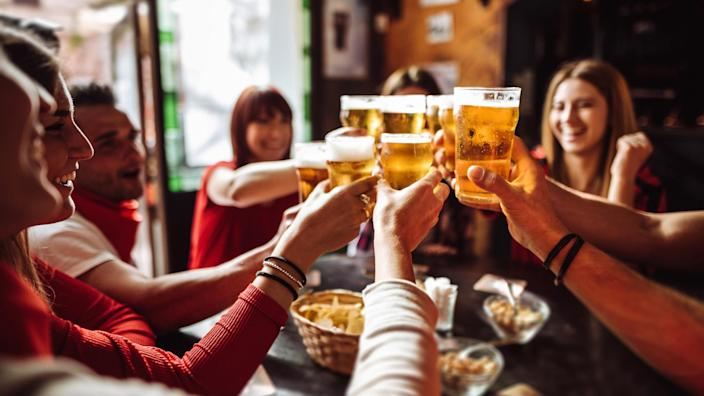 people talking toasting in a pub with the beers.