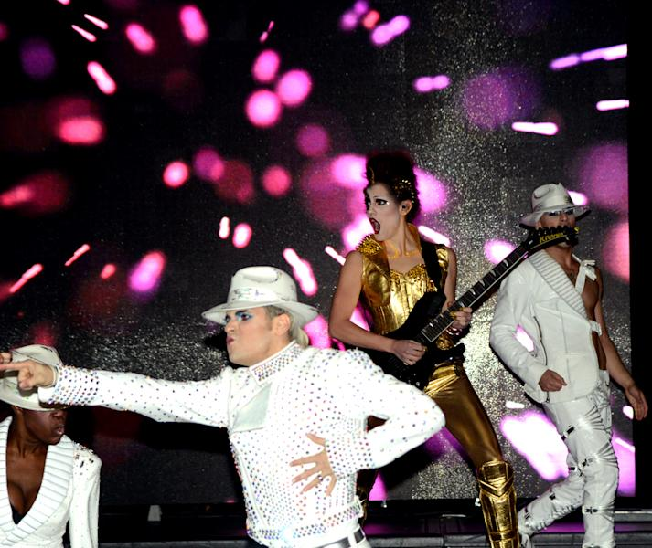 """In this photo provided by the Las Vegas News Bureau, performers dance during a preview of the new Cirque du Soleil show """"Michael Jackson ONE"""" Thursday, Feb. 21, 2013. The show at Mandalay Bay Resort and Casino on the Strip will start preview performances on May 23. It will officially premiere on June 29. (AP Photo/Las Vegas News Bureau, Glenn Pinkerton)"""