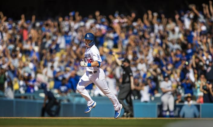 LOS ANGELES, CALIF. -- SUNDAY, JUNE 23, 2019: As the crowd cheers, Dodgers rookie Will Smith celebrates his three-run walk-off home run while rounding the bases in the bottom of the ninth inning to sweep the Rockies with three walk-offs at Dodger Stadium in Los Angeles, Calif., on June 23, 2019. Dodgers won 6-3. (Allen J. Schaben / Los Angeles Times)