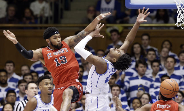 St. John's Marvin Clark II (13) fouls Duke's Cam Reddish (2) during the first half of an NCAA college basketball game in Durham, N.C., Saturday, Feb. 2, 2019. (AP Photo/Gerry Broome)