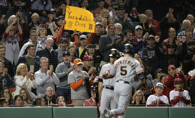 Fans cheer after a solo home run by San Francisco Giants' Mike Yastrzemski (5) in the fourth inning of a baseball game against the Boston Red Sox at Fenway Park in Boston, Tuesday, Sept. 17, 2019. Yastrzemski is the grandson of Red Sox great and Hall of Famer Carl Yastrzemski. (AP Photo/Charles Krupa)