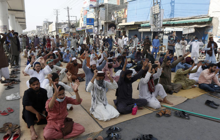 Angry supporters of Tehreek-e-Labiak Pakistan, a radical Islamist political party, block a road and chant slogans during a sit-in protest against the arrest of their party leader Saad Rizvi, in Lahore, Pakistan, Tuesday, April 13, 2021. A few demonstrators and policeman were killed Tuesday in violent clashes between Islamists and police in Pakistan, hours after authorities arrested Rizvi in the eastern city of Lahore, a senior official and local media reported. (AP Photo/K.M. Chaudary)