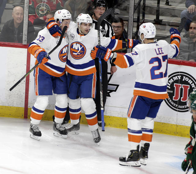 New York Islanders right wing Jordan Eberle (7) celebrate his first period goal of an NHL hockey game against the Minnesota Wild with teammates Mathew Barzal (13) and Anders Lee (27) Sunday, March 17, 2019, in St. Paul, Minn. (AP Photo/Paul Battaglia)
