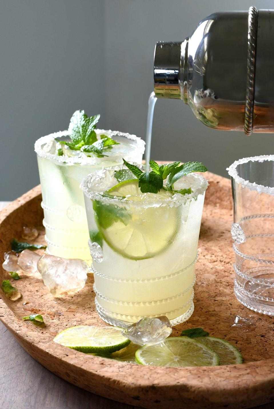 """<p><strong>Recipe: <a href=""""https://www.southernliving.com/recipes/mojitarita-cocktail"""" rel=""""nofollow noopener"""" target=""""_blank"""" data-ylk=""""slk:Mojitarita"""" class=""""link rapid-noclick-resp"""">Mojitarita</a></strong></p> <p>A cross between two epic cocktails, this recipe gets a super fresh kick from mint. We'd recommend topping with Topo Chico's Twist of Lime flavor. </p>"""