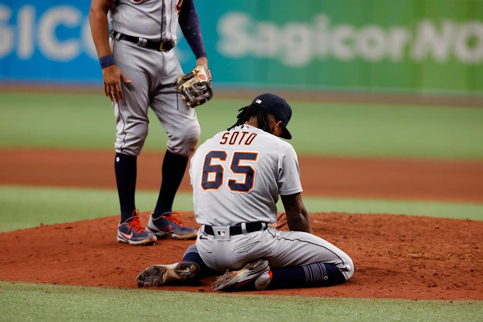 Detroit Tigers pitcher Gregory Soto kneels on the field after getting hit by the ball during the ninth inning against the Tampa Bay Rays, Friday, Sept. 17, 2021, in St. Petersburg, Fla.