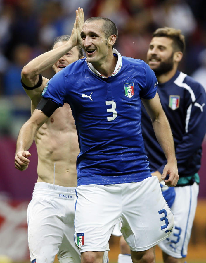 Italy's Giorgio Chiellini, foreground, Federico Balzaretti, left, and Antonio Nocerino celebrate their side's 2-1 win at the end of the Euro 2012 soccer championship semifinal match between Germany and Italy in Warsaw, Poland, Thursday, June 28, 2012. (AP Photo/Frank Augstein)