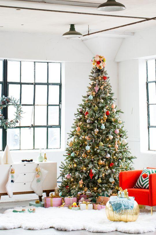 """<p>The ornaments are cute and all, but the pom-pom tree topper is what really makes the biggest statement in this display. </p><p><em><a href=""""https://sugarandcloth.com/diy-tree-topper-holiday-space-martha-stewart/"""" rel=""""nofollow noopener"""" target=""""_blank"""" data-ylk=""""slk:Get the tutorial at Sugar & Cloth »"""" class=""""link rapid-noclick-resp"""">Get the tutorial at Sugar & Cloth »</a></em></p>"""