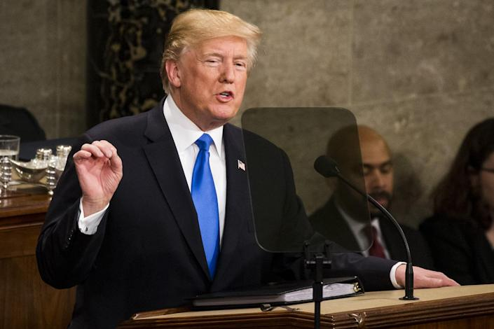 <p>Trump gives his first State of the Union address to Congress and the country on Jan. 30. (Photo: Samuel Corum/Anadolu Agency/Getty Images) </p>