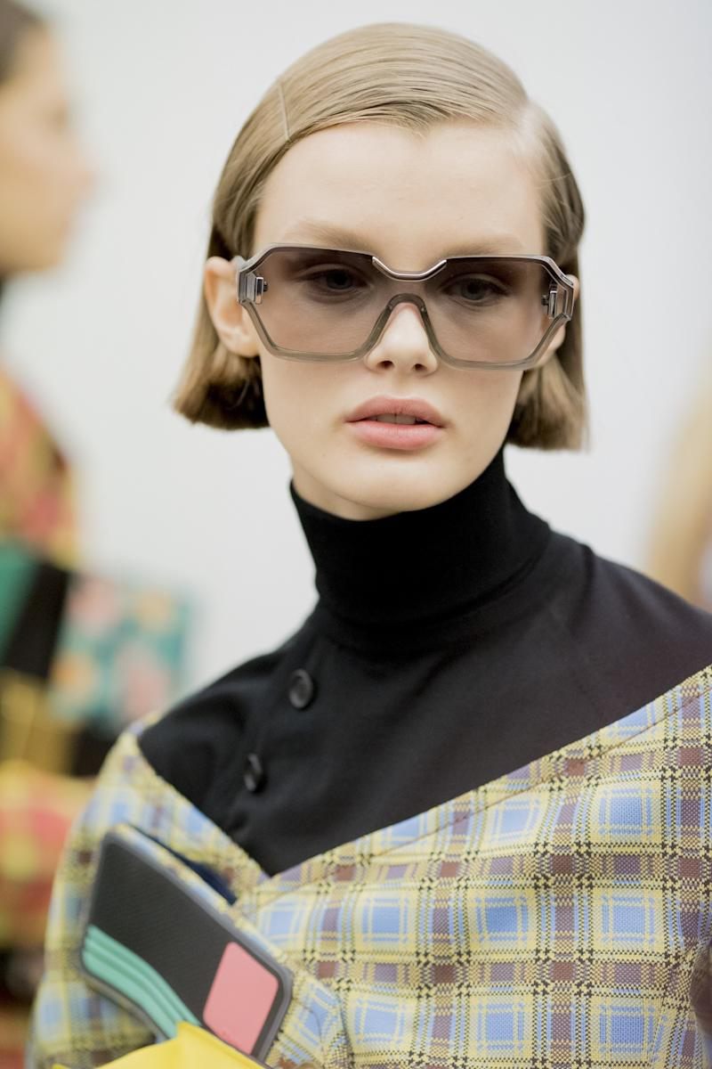 Backstage at Prada's Spring 2017 show, Palau delivered a series of on-the-spot radical haircuts, turning models into freshly bobbed minimalist beauties.