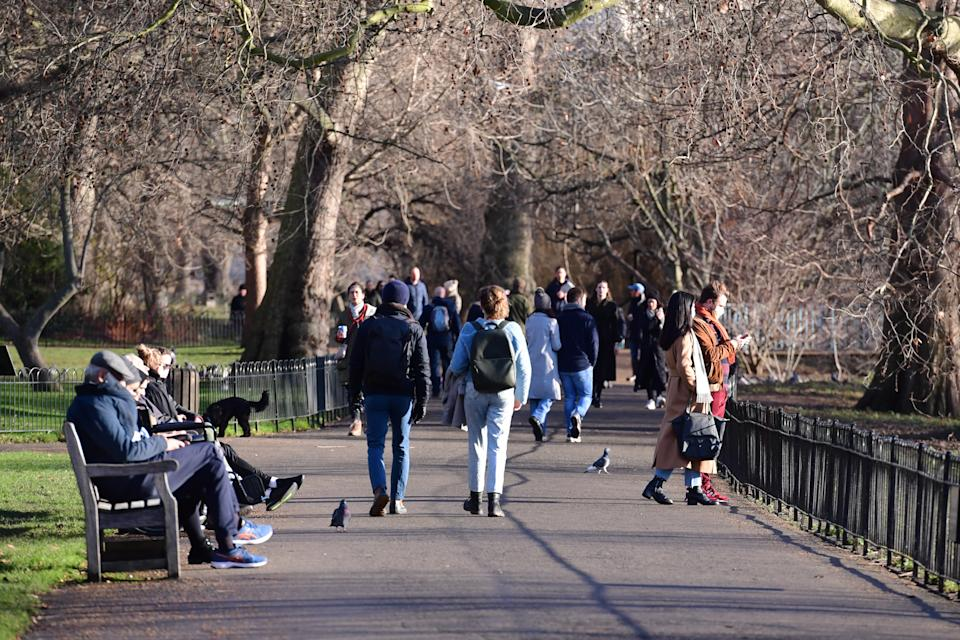 People walk in Green Park, London, during England's third national lockdown to curb the spread of coronavirus.
