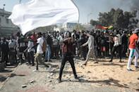 Thousands of young protesters also looted shops, hurled stones at police and torched cars during demonstrations