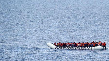 Migrants wait to be rescued by