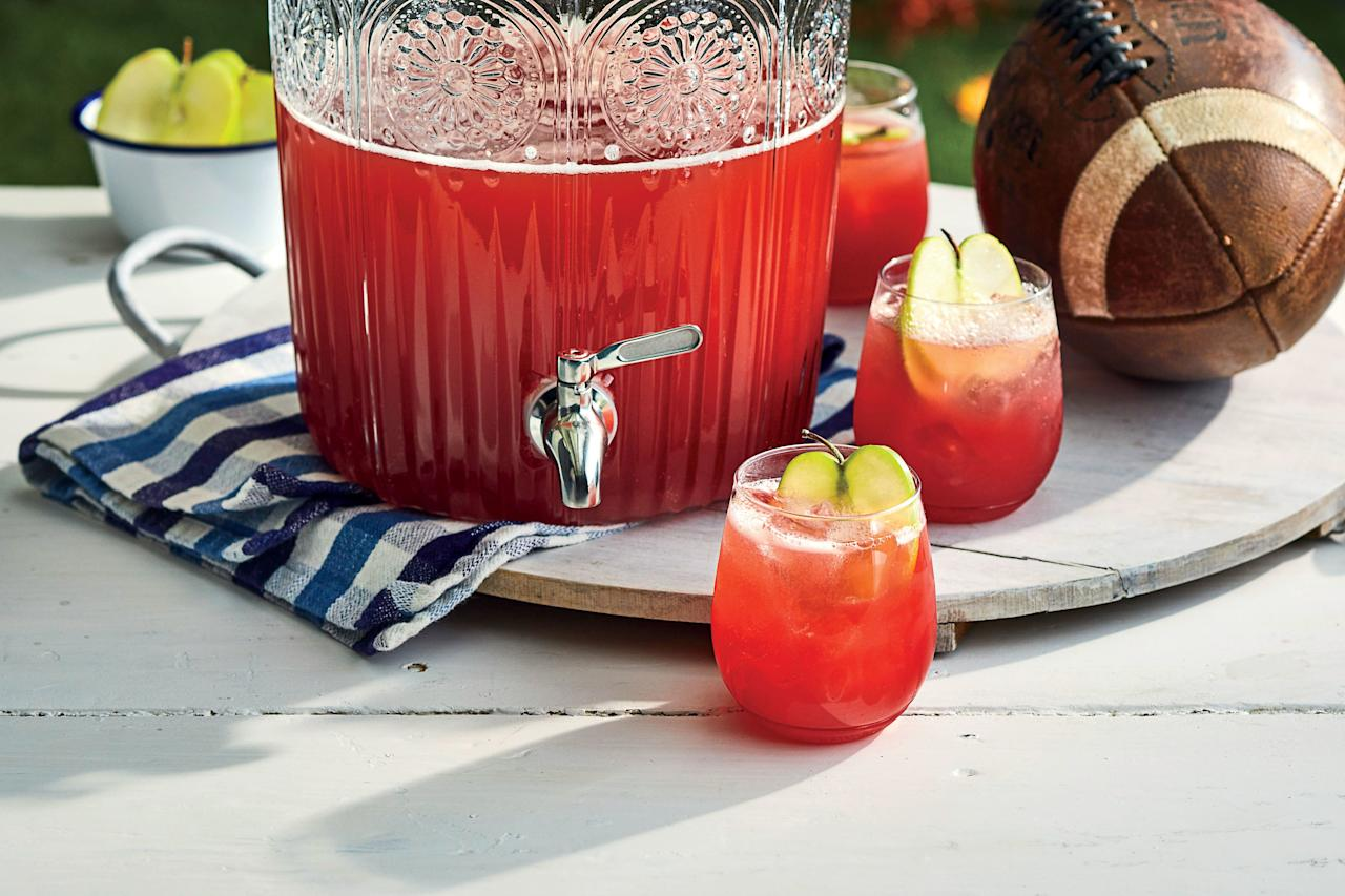 """<p>We created this <a href=""""https://www.southernliving.com/food/entertaining/sparkling-punch"""">refreshing punch</a> with tailgating in mind, but it would be a hit at fall gathering. Made with frozen cranberries, sparkling apple cider, honey, brown sugar, fresh lemon juice, and <a href=""""https://www.southernliving.com/drinks/cocktails/souths-best-bourbon"""">bourbon</a>, it's deliciously sweet and tangy. Frozen cranberries are best for this recipe; be sure to let them thaw before you add them to the food processor.</p> <p><a href=""""https://www.myrecipes.com/recipe/whiskey-apple-cider-punch"""">Whiskey-Apple Cider Punch Recipe</a></p>"""