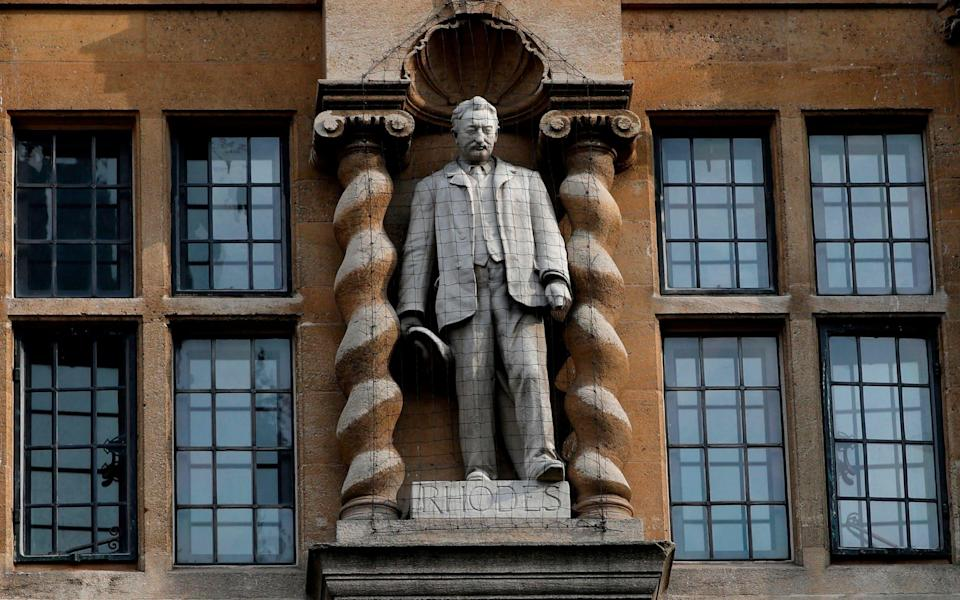 A statue of Cecil John Rhodes outside Oriel College at the University of Oxford - Adrian Dennis/AFP