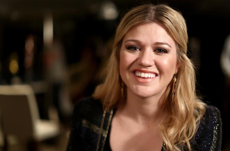 "In this Monday, Nov. 5, 2012 photo, musician Kelly Clarkson poses for a portrait in Los Angeles.  Clarkson's newest album, ""Greatest Hits: Chapter One,"" is releasing on Monday, Nov. 19, 2012.  (Photo by Matt Sayles/Invision/AP)"