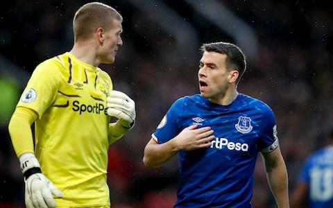 verton captain Seamus Coleman (right) has words with goalkeeper Jordan Pickford  - Credit: PA