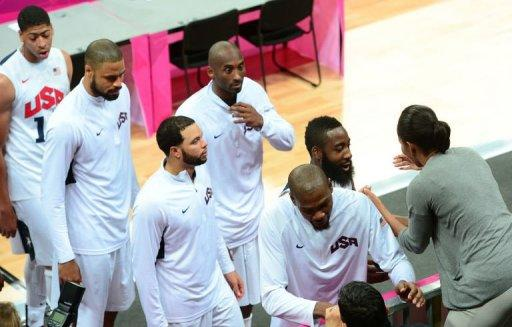 US basketball players are congratulated by US First Lady Michelle Obama