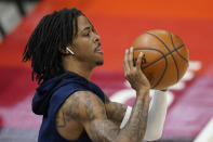 Memphis Grizzlies guard Ja Morant warms up before their Game 2 of their NBA basketball first-round playoff series against the Utah Jazz Wednesday, May 26, 2021, in Salt Lake City. (AP Photo/Rick Bowmer)