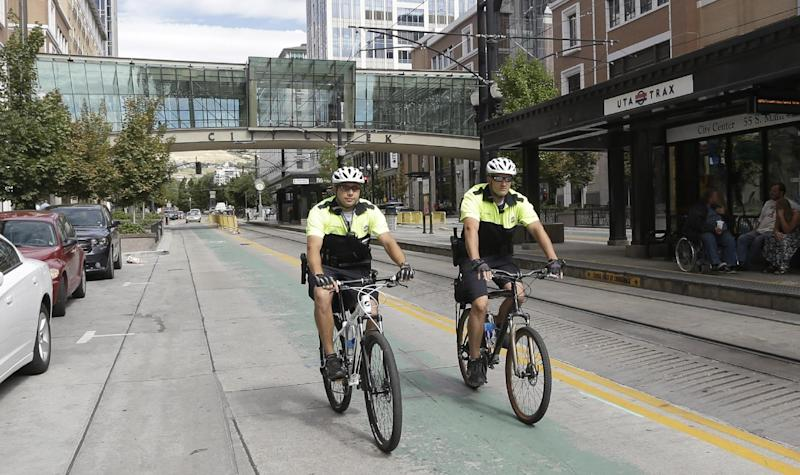 """A Salt lake City Police bike patrol ride in front of City Creek shopping center Tuesday, Sept. 24, 2013, in Salt lake City, Utah. Jack Harry Stiles, a Utah man accused of plotting a deadly attack on a luxe outdoor shopping center in the heart of Salt Lake City this week told investigators he planned to """"just randomly shoot and kill people."""" (AP Photo/Rick Bowmer)"""