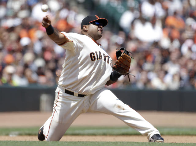 San Francisco Giants third baseman Pablo Sandoval throws out Chicago Cubs' Junior Lake at first base in the fifth inning of their baseball game, Sunday, July 28, 2013, in San Francisco. (AP Photo/Eric Risberg)