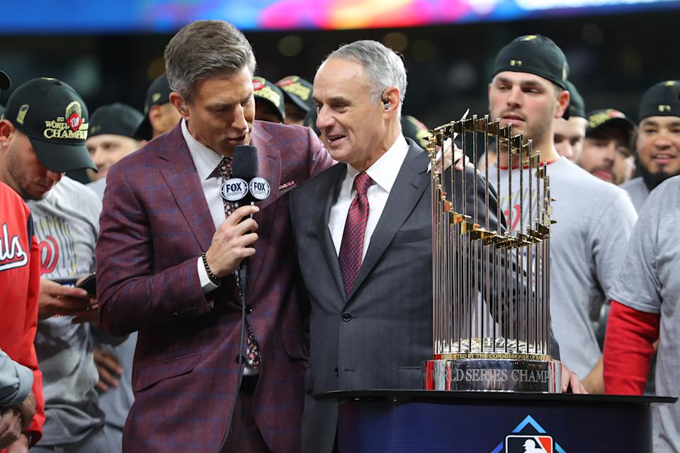 HOUSTON, TX - OCTOBER 30: Major League Baseball Commissioner Robert D. Manfred Jr. talks with Fox Sports commentator Chris fowler during the World Series trophy presentation after the Nationals defeat the Houston Astros in Game 7 to win the 2019 World Series at Minute Maid Park on Wednesday, October 30, 2019 in Houston, Texas. (Photo by Alex Trautwig/MLB Photos via Getty Images)