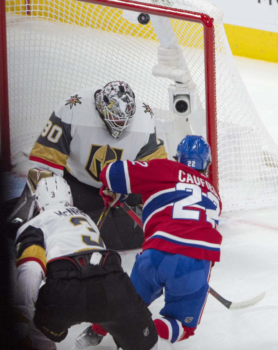 Montreal Canadiens' Cole Caufield (22) scores on Vegas Golden Knights goaltender Robin Lehner (90) during the second period in Game 6 of an NHL hockey Stanley Cup semifinal playoff series Thursday, June 24, 2021 in Montreal. (Ryan Remiorz/The Canadian Press via AP)
