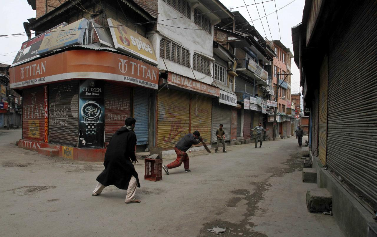 Kashmiri boys play cricket at a closed market area during a strike in Srinagar, India, Saturday, April 9, 2011. Shops and schools in Indian-controlled Kashmir are closed to protest the blast that killed a moderate Muslim religious leader outside a mosque in the disputed Himalayan region.