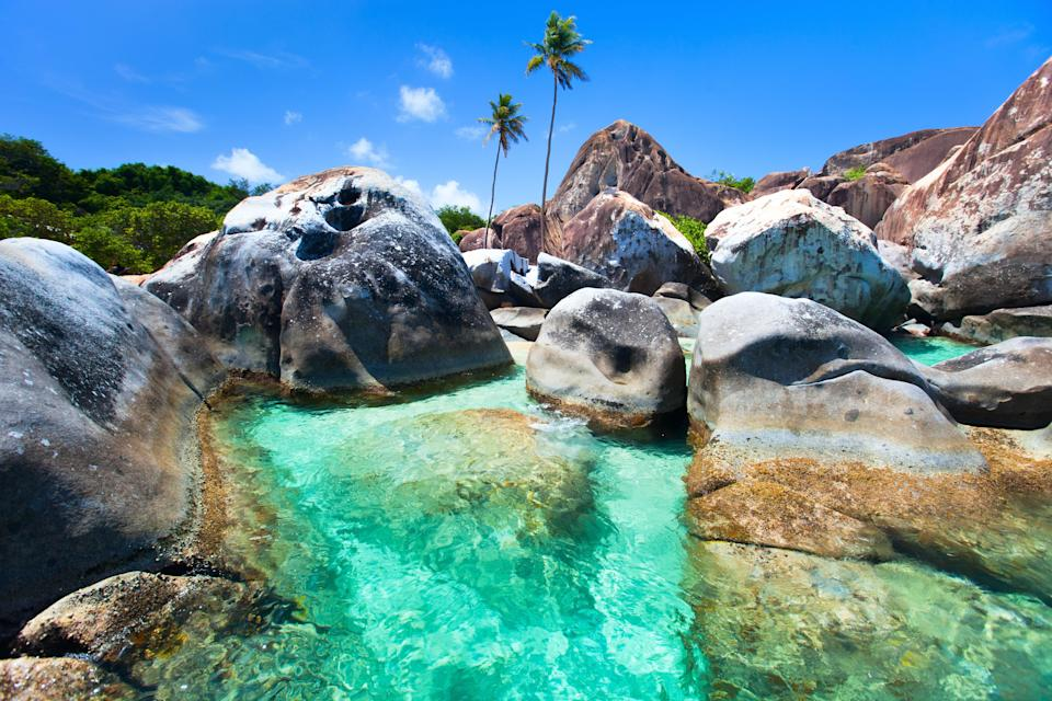Virgin Gorda is the third-largest of the British Virgin Islands, with natural beauty covering virtually all of its 8.5 square miles. The island offers quiet beaches, coves, and flora-filled national parks. Perhaps the prettiest and most popular attraction is the Baths, pictured, a seaside area where huge granite boulders form scenic saltwater pools and grottos.
