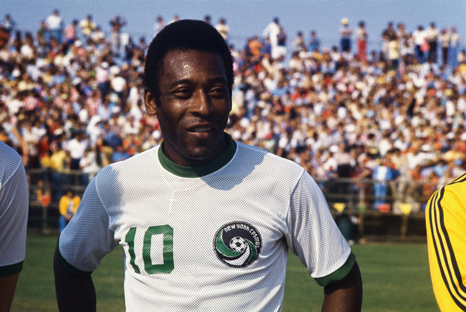 (Original Caption) Miami, Florida: Head and shoulders portrait of the New York Cosmos soccer sensation Pele standing on the field in New York Cosmos uniform. The crowd can be seen in the background.
