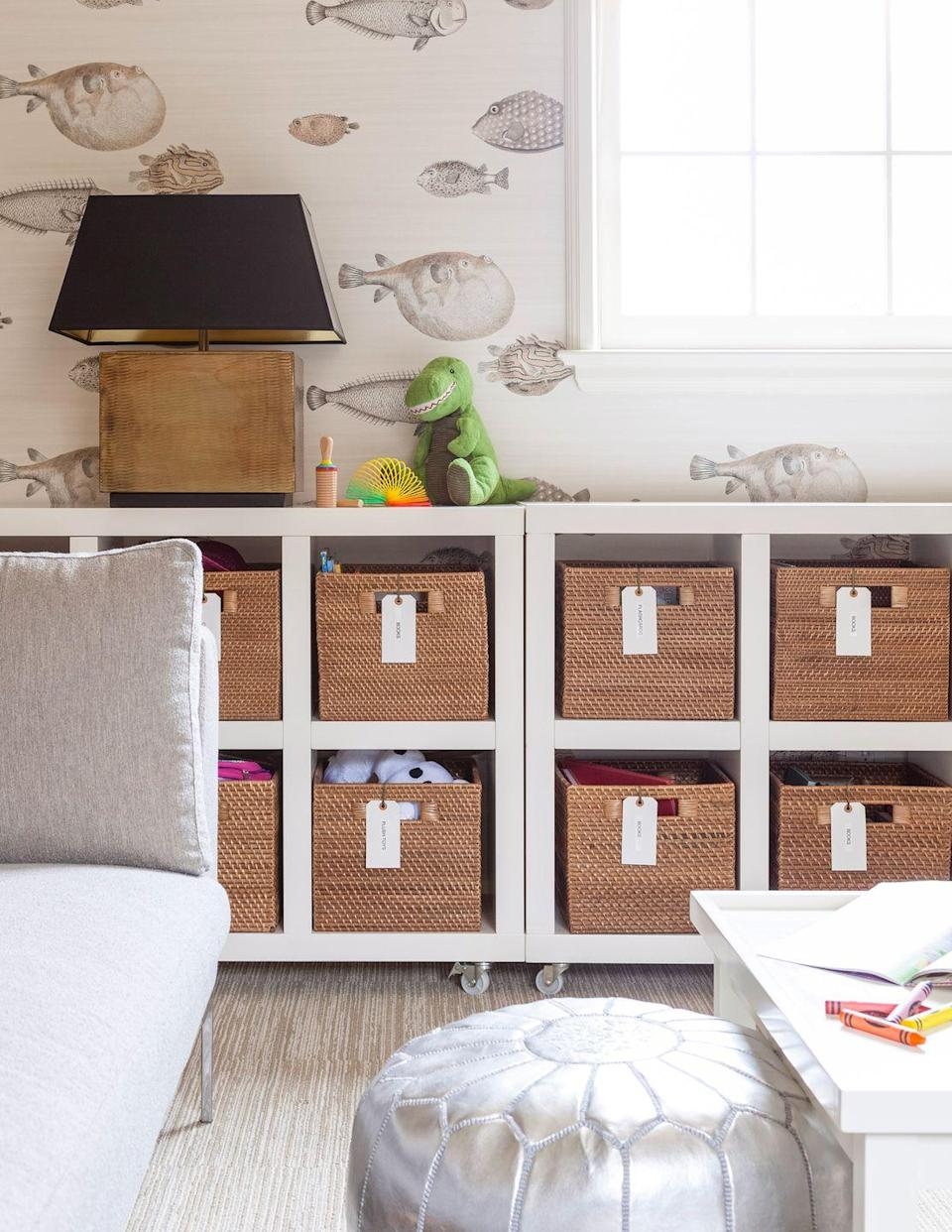 <p>A well-organized nursery will ensure a soothing setting for both baby and parents. Keep clutter to a minimum and essentials easy to find and grab with labeled containers in open cabinets. Then add some fanciful twists with playful neutral-hued wallpaper and metallic accents, like the silver pouf designer Jean Liu opted for here. </p>