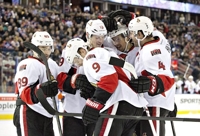 Ottawa Senators' Cory Conacher (89), Jason Spezza (19) Milan Michalel (9), Cody Ceci (5) and Chris Phillips (4) celebrate a goal against the Edmonton Oilers during the first period of an NHL hockey game, Tuesday, March 4, 2014 in Edmonton, Alberta. (AP Photo/The Canadian Press, Jason Franson)