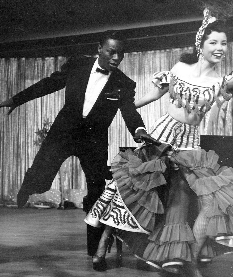 <p>While filming the movie <em>The Nat 'King' Cole Story </em>in Las Vegas, Nat King Cole dances a number with a showgirl.</p>