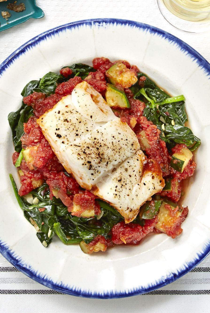 """<p>If you're out of cod, swap the fish for tilapia or salmon for another variation of this easy-to-make meal. </p><p><em><a href=""""https://www.goodhousekeeping.com/food-recipes/a32410/mediterranean-cod-recipe-ghk0515/"""" rel=""""nofollow noopener"""" target=""""_blank"""" data-ylk=""""slk:Get the recipe for Mediterranean Cod »"""" class=""""link rapid-noclick-resp"""">Get the recipe for Mediterranean Cod »</a></em></p>"""