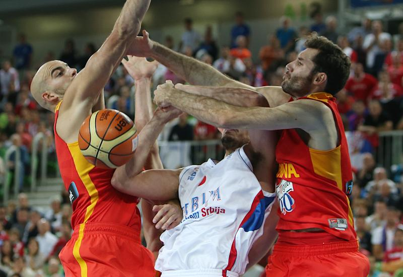 Serbia's Nemanja Bjelica, center, is fouled Spain's Rudy Fernandez, right, as Xavier Rey defend during their EuroBasket European Basketball Championship quarterfinal match at the Stozice Arena, in Ljubljana, Slovenia, Wednesday, Sept. 18, 2013. (AP Photo/Thanassis Stavrakis)